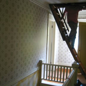Stripping The Old Wallpaper in the Upstairs Hallway
